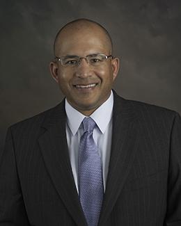 Javier E. Carles,MD