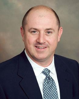Clarence E. Coker, III,MD